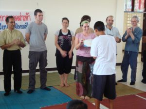 Boy trained in massage receives his certificate.