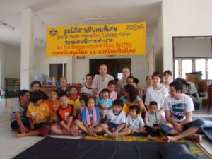 Group of Thai children and international trainers.