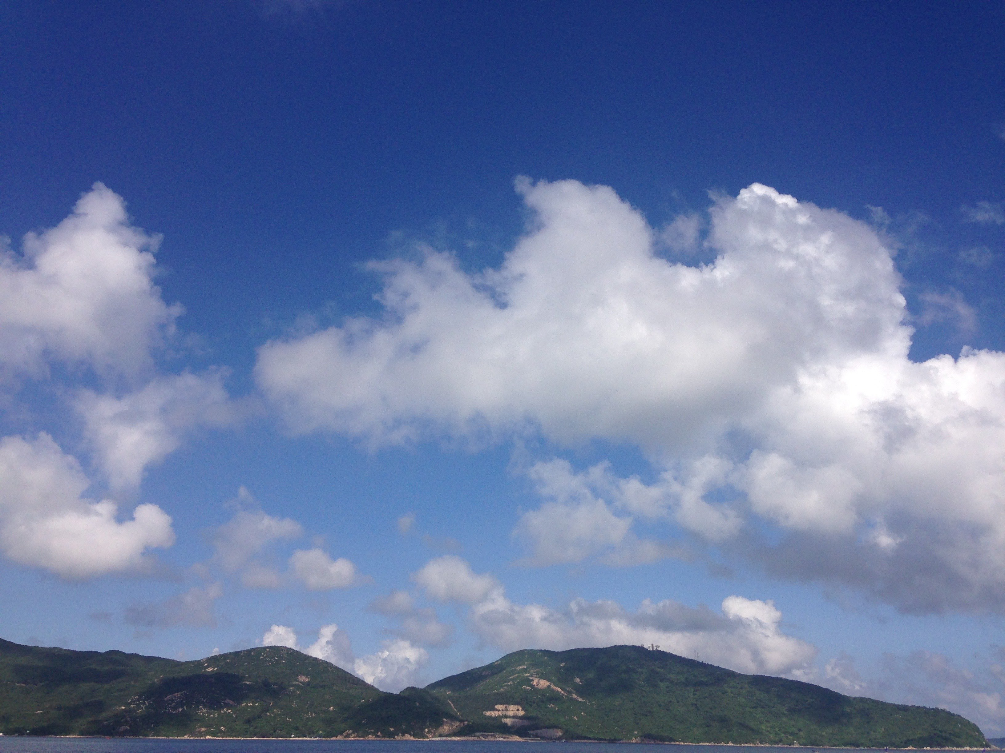 Hills, blue sky and clouds.