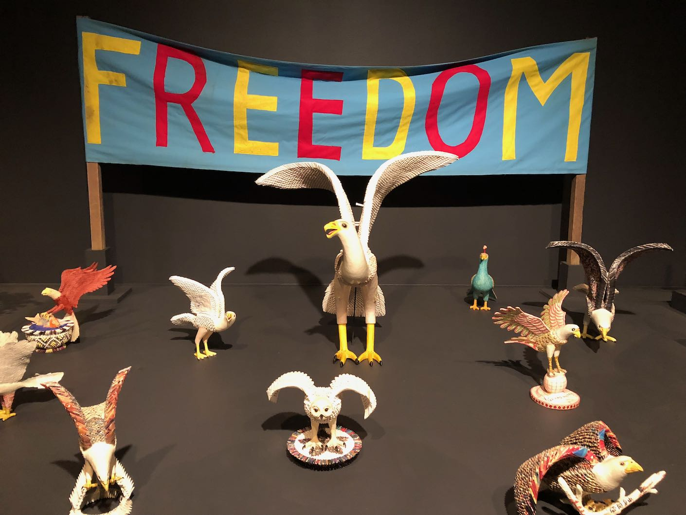 Models of birds in front of a banner reading 'Freedom'.